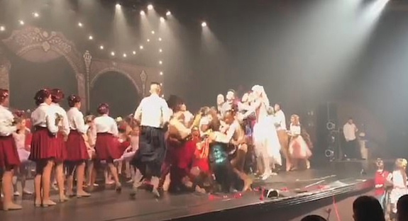 They brought the house down… and the stage! Dancers crash through the floor as they enthusiastically celebrate the end of their performance in Brazil